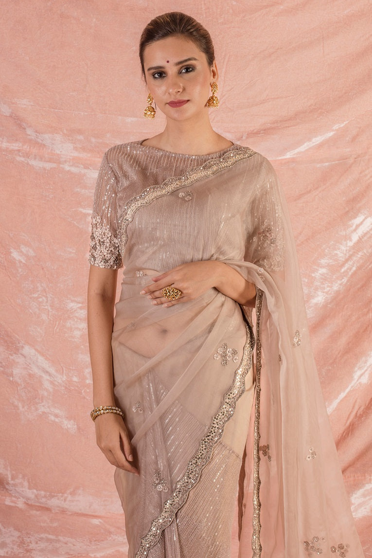 Buy beautiful pink embroidered organza saree online in USA with saree blouse. saree has simple silver border work. Blouse is of elbow length and has embroidery work. Be the talk of parties and weddings with exquisite designer sarees, embroidered sarees from Pure Elegance Indian clothing store in USA. Shop online now.-close up
