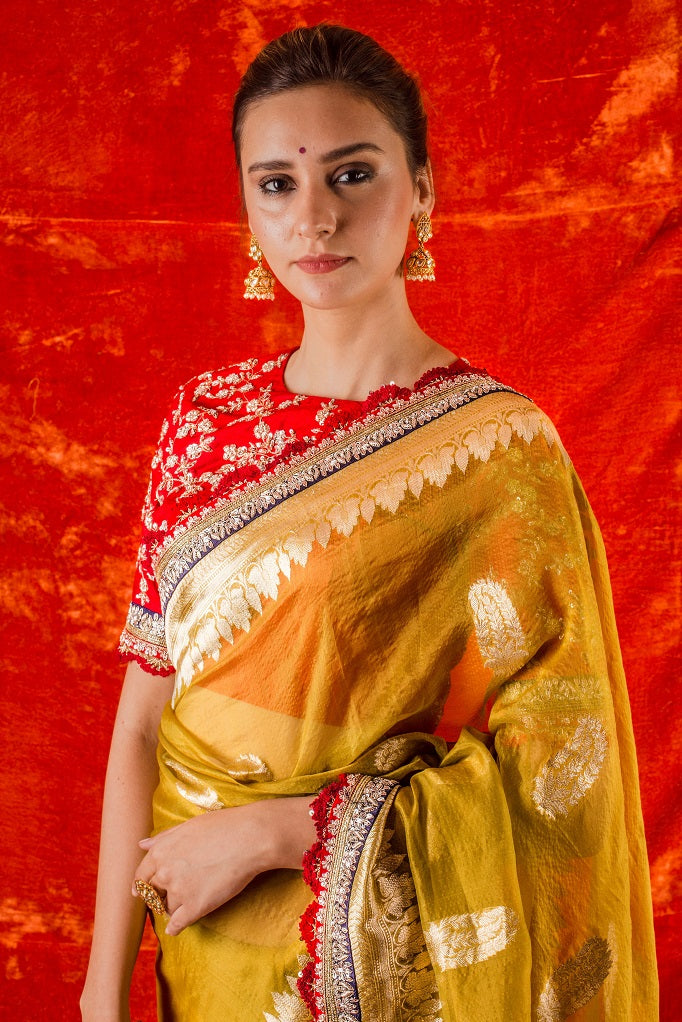 Buy mustard yellow embroidered handloom saree online in USA. Saree has fine heavy embroidery with buta design and simple red-blue border with golden prited design. Comes with red heavy blouse. Be the talk of parties, wedding with exquisite designer sarees from Pure Elegance Indian clothing store in USA.Shop online now.-close up