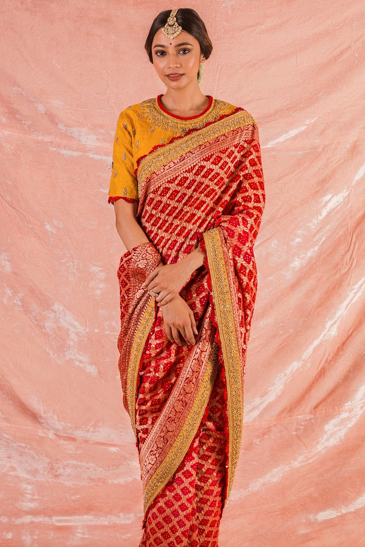 Buy red embroidered bandhej saree online in USA. Saree crafted with fine embroidery and heavy yellow border. Blouse of plain yellow color has detailed embroidery specially at the neck. Be the talk of parties and weddings with exquisite designer sarees from Pure Elegance Indian clothing store in USA.Shop online now.-full view