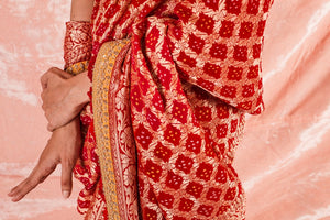 Buy red embroidered bandhej saree online in USA. Saree crafted with fine embroidery and heavy yellow border. Blouse of plain yellow color has detailed embroidery specially at the neck. Be the talk of parties and weddings with exquisite designer sarees from Pure Elegance Indian clothing store in USA.Shop online now.-close up
