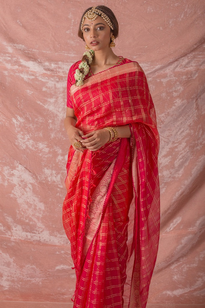 Buy red embroidered handloom saree online in USA. Saree has fine printed design and heavy printed border with checks on it. Blouse of red color has detailed embroidery around the neck. Be the talk of parties and weddings with exquisite designer sarees from Pure Elegance Indian clothing store in USA.Shop online now.-full view