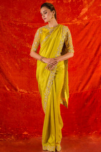 Buy yellow embroidered silk saree online in USA. Saree has fine heavy embroidery work and border. Blouse of yellow color has detailed embroidery work and net sleeves of elbow lenght. Be the talk of parties and weddings with exquisite designer sarees from Pure Elegance Indian clothing store in USA.Shop online now.-full view