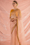 Buy pink embroidered organza saree online in USA. Saree has fine work and heavy yellow border. Blouse of yellow color has detailed embroidery work and embroidery around neck and sleeves. Be the talk of parties and weddings with exquisite designer sarees from Pure Elegance Indian clothing store in USA.Shop online now.-full view