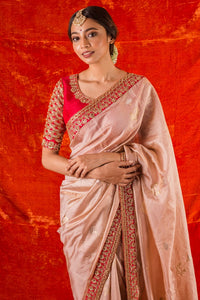 Buy pink embroidered handloom sari online in USA. Saree has fine gold printed work and heavy red border. Blouse of red color has heavy embroidery work around neck and sleeves. Be the talk of parties and weddings with exquisite designer sarees from Pure Elegance Indian clothing store in USA.Shop online now.-full view