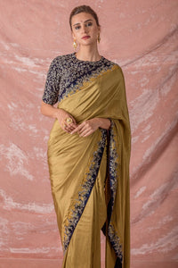 Buy brown embroidered silk saree online in USA. Saree has fine work and heavy blue border with silver design. Blue blouse has heavy silver embroidery work and its of elbow length. Be the talk of parties and weddings with exquisite designer sarees from Pure Elegance Indian clothing store in USA.Shop online now.-full view