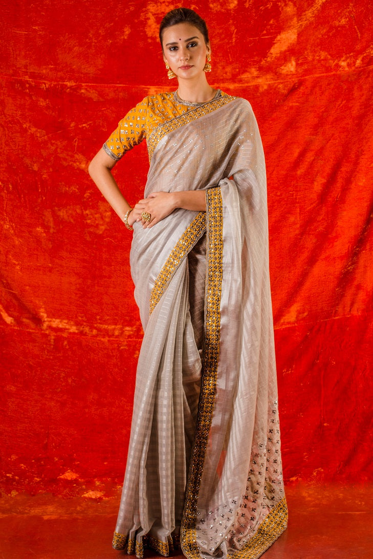 Buy grey embroidered handloom saree online in USA. Saree has fine work and yelloe border with silver work. Yellow blouse has heavy embroidery work and its of elbow length. Be the talk of parties and weddings with exquisite designer sarees from Pure Elegance Indian clothing store in USA.Shop online now.-full view
