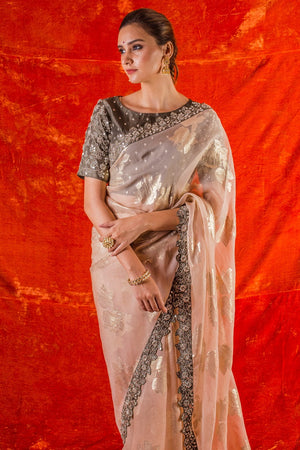 Buy beautiful offwhite embroidered organza saree with blouse online in USA. Saree crafted with fine embroidery,has floral design,heavy grey border.Grey color blouse has fine silver design. Be the talk of parties and weddings with exquisite designer sarees from Pure Elegance Indian clothing store in USA.Shop online now.-close up