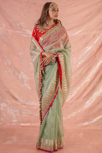 Buy beautiful green embroidered handloom saree with matching red blouse online in USA. Saree is crafted with fine embroidery and heavy gold border and matching heavy red bandhej blouse. Be the talk of parties and weddings with exquisite designer sarees from Pure Elegance Indian clothing store in USA.Shop online now.-full view