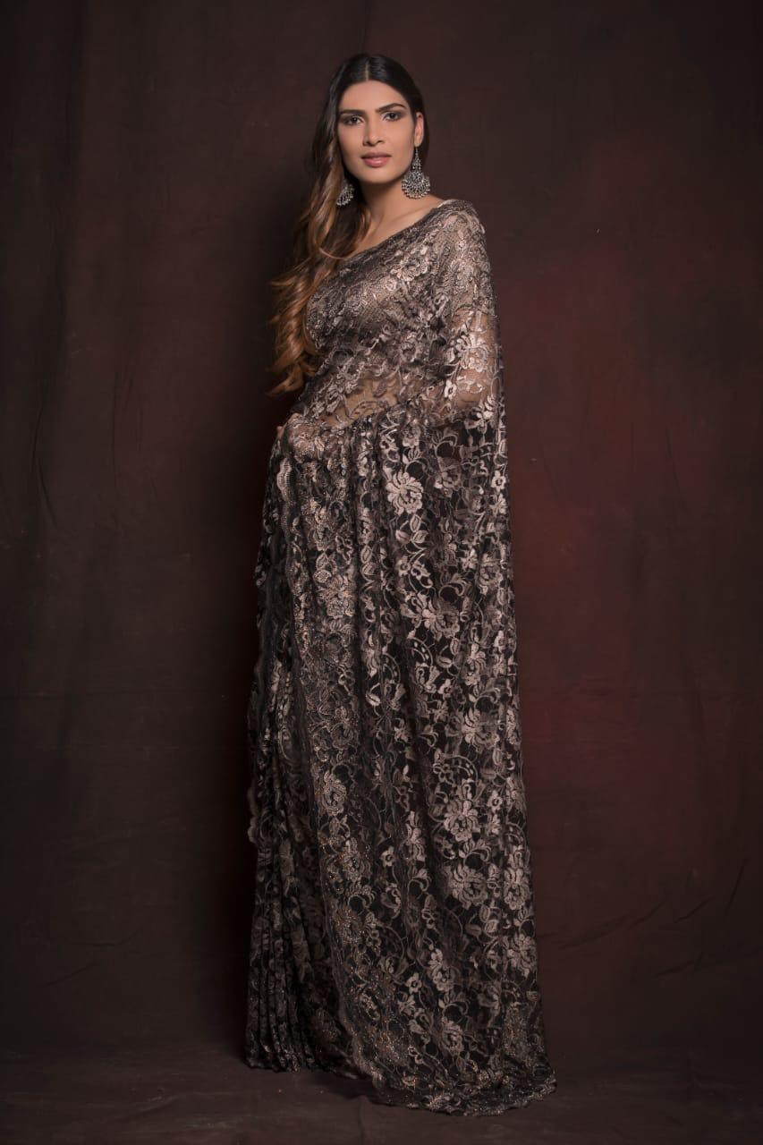 Shop beautiful grey designer lace saree online in USA. Be the talk of parties and weddings with exquisite designer sarees, embroidered sarees, pure silk saris, handwoven sarees from Pure Elegance Indian clothing store in USA.Shop online now.-full view