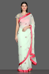 Buy elegant mint green embroidered georgette sare online in USA with pink sheer saree blouse. Make a fashion statement at weddings with stunning designer sarees, embroidered sarees with blouse, wedding sarees from Pure Elegance Indian fashion store in USA.-full view