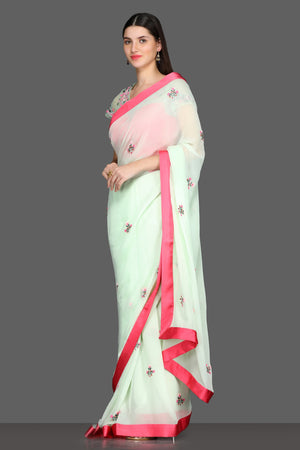 Buy elegant mint green embroidered georgette sare online in USA with pink sheer saree blouse. Make a fashion statement at weddings with stunning designer sarees, embroidered sarees with blouse, wedding sarees from Pure Elegance Indian fashion store in USA.-side