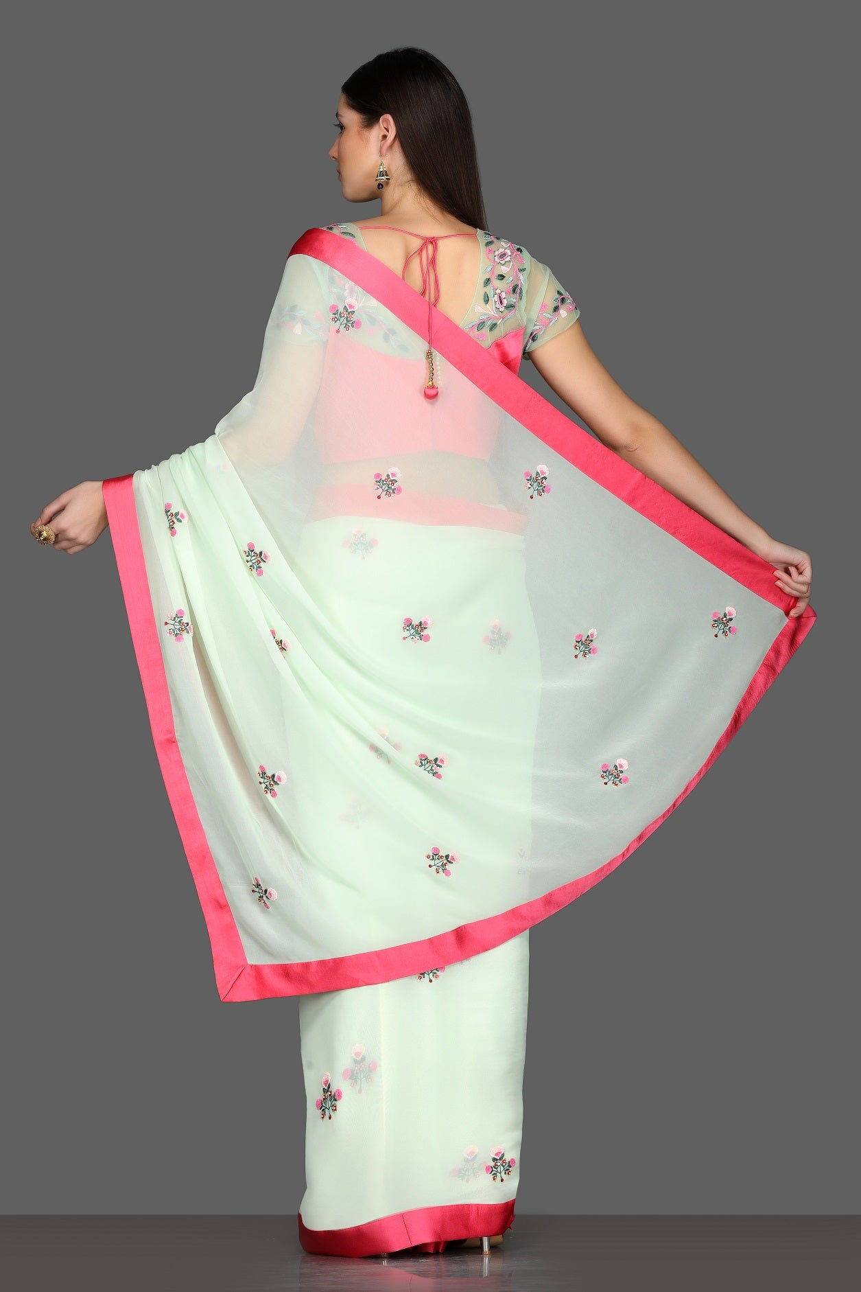 Buy elegant mint green embroidered georgette sare online in USA with pink sheer saree blouse. Make a fashion statement at weddings with stunning designer sarees, embroidered sarees with blouse, wedding sarees from Pure Elegance Indian fashion store in USA.-back