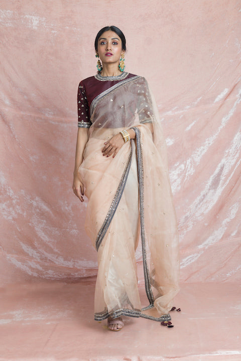 Buy beautiful beige embroidered organza saree online in USA with wine color embroidered saree blouse. Champion ethnic fashion on weddings and festivals with a stunning collection of designer sarees, handloom saris with blouse, wedding sarees, from Pure Elegance Indian fashion store in USA.-full view
