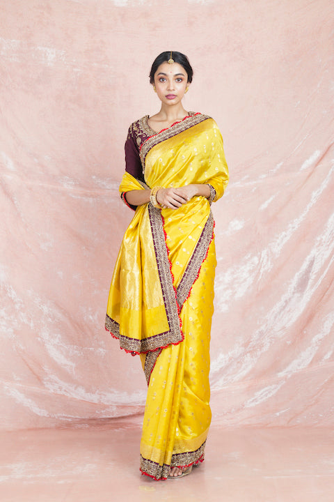 Shop stunning yellow embroidered handloom sari online in USA with brown embroidered saree blouse. Champion ethnic fashion on weddings and festivals with a stunning collection of designer sarees, handloom sarees with blouse, wedding sarees, from Pure Elegance Indian fashion store in USA.-full view