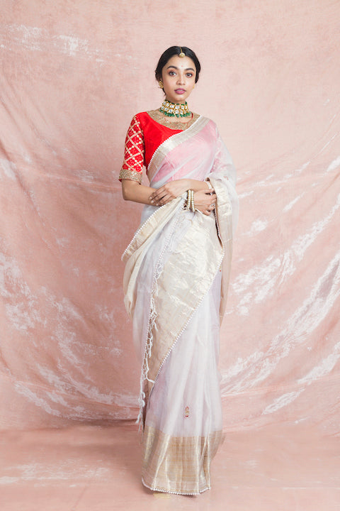 Buy exquisite off-white embroidered handloom sari online in USA with red embroidered sari blouse. Champion ethnic fashion on weddings and festivals with a stunning collection of designer sarees, handloom sarees with blouse, bridal sarees, from Pure Elegance Indian fashion store in USA.-full view