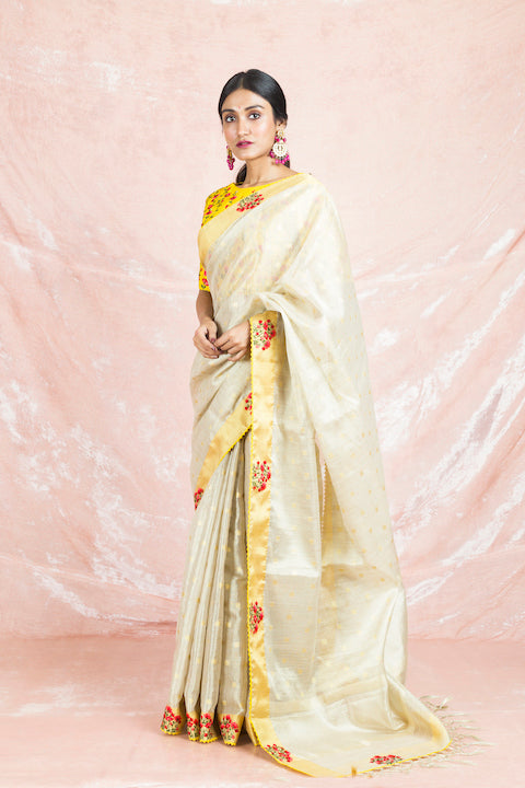 Buy beautiful cream embroidered handloom saree online in USA with embroidered yellow sari blouse. Champion ethnic fashion on weddings and festivals with a stunning collection of Banarasi sarees, handloom sarees with blouse, bridal sarees, from Pure Elegance Indian fashion store in USA.-full view