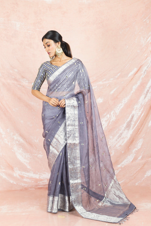 Shop gorgeous grey mirror work handloom saree online in USA with embroidered sari blouse. Champion ethnic fashion on weddings and festivals with a stunning collection of Banarasi sarees, handloom sarees with blouse, bridal sarees, from Pure Elegance Indian fashion store in USA.-full view