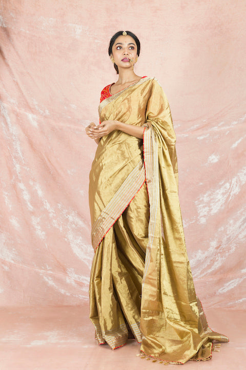 Shop gorgeous golden handloom saree online in USA with red bandhej saree blouse. Champion ethnic fashion on weddings and festivals with a stunning collection of Banarasi sarees, handloom sarees with blouse, bridal sarees, from Pure Elegance Indian fashion store in USA.-full view