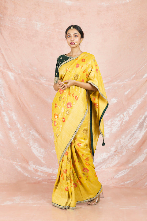 Buy beautiful yellow color embroidered handloom saree online in USA with embroidered green saree blouse. Champion ethnic fashion on weddings and festivals with a stunning collection of Banarasi sarees, handloom sarees with blouse, bridal sarees, from Pure Elegance Indian fashion store in USA.-full view