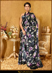 Buy gorgeous black satin georgette sari online in USA with floral digital print. Make a fashion statement at weddings with stunning designer sarees, embroidered sarees with blouse, wedding sarees, handloom saris, printed saris from Pure Elegance Indian fashion store in USA.-full view