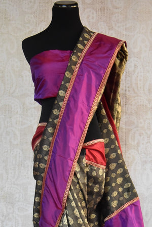 90A464 This black, purple & gold Indian saree will be a wonderful addition to your Indian clothing collection. Available online at our Indian outfits store, this Benarasi silk saree can be used as a wedding outfit & as a party saree. This is an eye-catching saree you're sure to love for years and years to come!