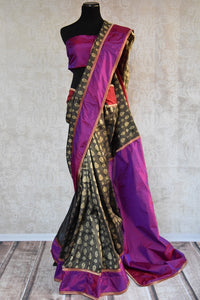 90A464 This black, purple & gold Indian saree will be a wonderful addition to your Indian clothing collection. Available online at our Indian outfits store, this Benarasi silk saree can be used as a wedding outfit & as a party saree. Don't miss out on picking up this beautiful and unique saree from India.