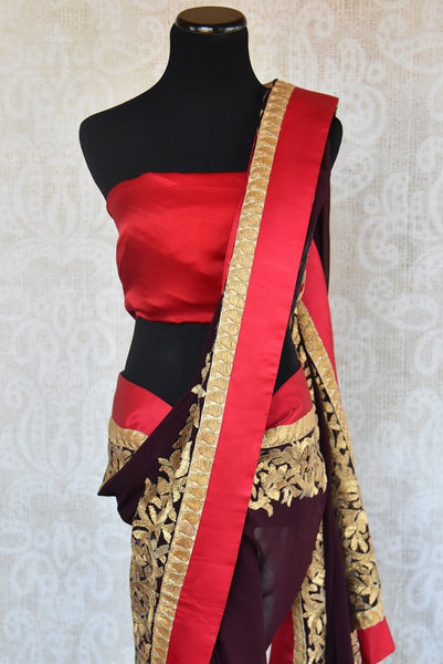 90A704 Chiffon sarees are a must-have in any Indian wear collection & this brown and red saree with traditional golden zari antique work can be bought from our ethnic clothing store online in USA.