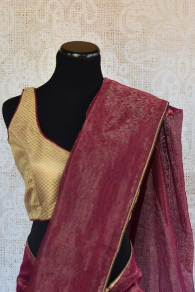 90B022 Maroon linen saree with a golden ready made blouse. This simple saree, available online at our ethnic wear store in USA - Pure Elegance makes for a striking Indian outfit and is well suited for Indian functions and festivities.
