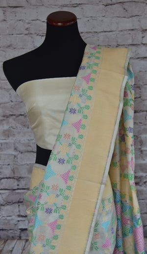 90B250 Beautiful white Banarasi weave silk saree with an elegant cream border and classic pastel colored floral phulkari design. Buy this party wear saree online in USA from our Indian fashion store - Pure Elegance.