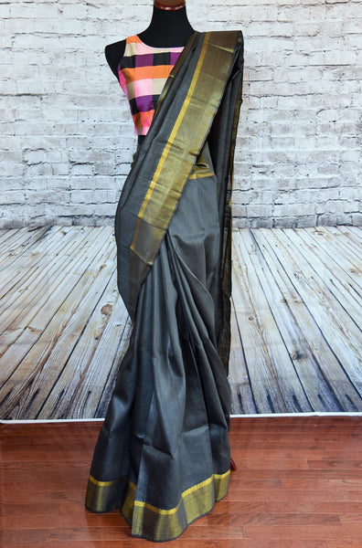 90B505 Charcoal grey bhagalpur tussar simple saree with golden border. This Indian outfit available online in USA at Pure Elegance is perfect for Indian wedding receptions & parties. Versatile and classic, you'll love having this saree in your ethnic wear wardrobe.