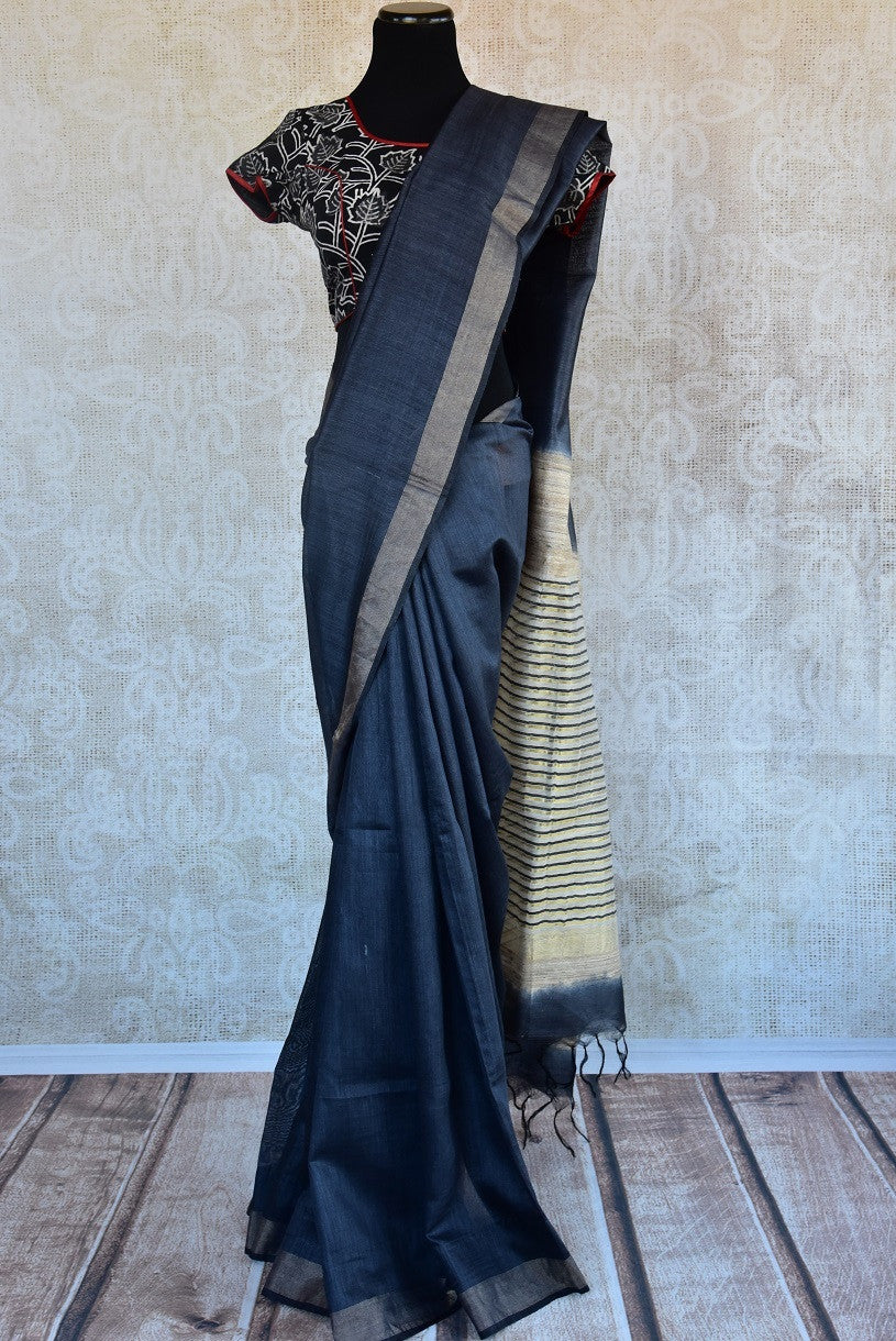 90B509 Blue tussar saree with striped beige pallu available online at our traditional Indian ethnic wear store Pure Elegance. The simple saree is great for pujas and ethnic get-togethers.