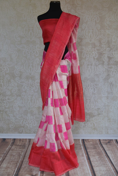 90B646 Matka banarasi printed sari in red, pink & white hues. Buy this simple sari ideal for casual occasions, pujas & small wedding functions at our ethnic wear store online and in Edison (USA). Vintage with a dash of modern, this is indeed a unique Indian outfit.