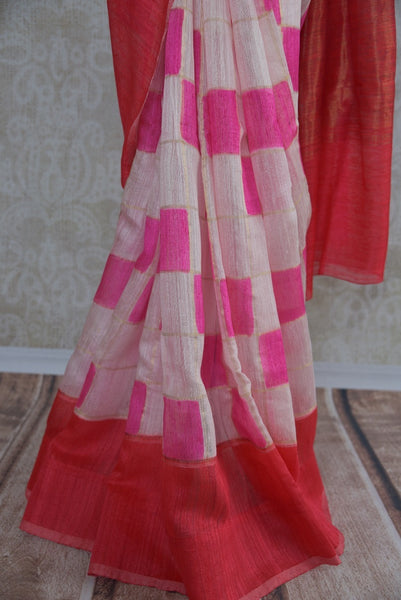90B646 Matka banarasi printed sari in red, pink & white colors. Buy this simple sari online in USA, perfect for casual occasions, pujas & small wedding functions at our ethnic clothing store - Pure Elegance. Vintage with a dollop of modern, this is indeed a unique Indian outfit.
