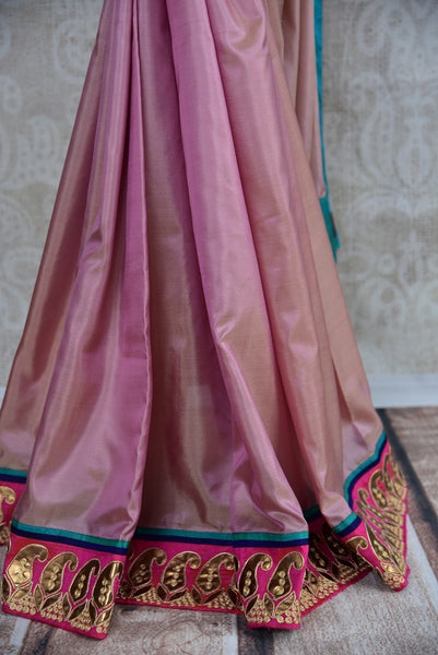 90B972 Buy shimmer pink saree with pops of blue online at Pure Elegance. The exquisite silk party wear saree will be a lovely addition to your ethnic wear wardrobe. This sari is sure to make a gorgeous and bold statement wherever you go.