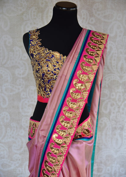 90B972 Ravishing shimmer pink saree with pops of blue and golden along the border. The ethnic silk party wear saree available online in USA at Pure Elegance is sure to keep all eyes on you!