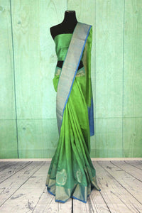 90C180 Gorgeous green blue saree online at Pure Elegance The traditional matka ghicha Banarasi sari from India is ideal to wear at festivals and ethnic parties. The simple saree can be styled in very many ways.