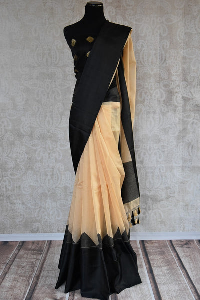 90C109 Beige linen saree with a bold black satin border available at our ethnic clothing store in USA. The simple saree for India makes for a great party wear Indian outfit. The versatile saree can be styled in many ways.