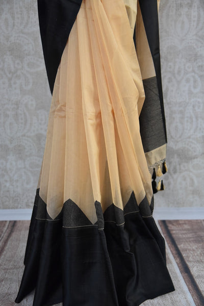 90C109 Beige linen saree with a bold black satin border available at our ethnic clothing store in USA. The simple saree for India makes for a great party wear outfit. You will love having this versatile saree in your Indian clothing collection.