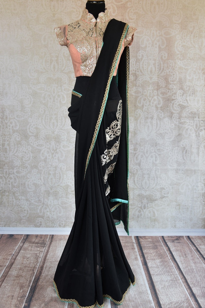 90C147 Georgette saree with embroidery work and a thin gold border. Buy this black party wear saree with peach blouse online in USA at Pure Elegance - our Indian clothing store.