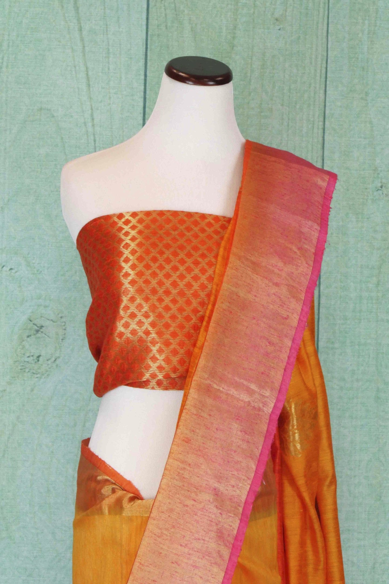 90C181 Shaded orange and yellow, matka ghicha benarasi saree, with a soft gold border and traditional motifs. Buy this Indian saree, ideal for ethnic festivities, online in USA at Pure Elegance.