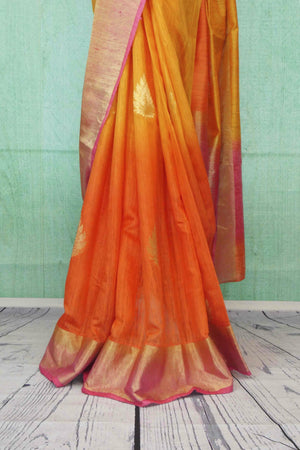 90C181 Alluring shaded orange and yellow, matka ghicha banarasi saree, with a soft gold border and traditional motifs. Buy this Indian saree online in USA at Pure Elegance. This one is a perfect pick for festive occasions, pujas and wedding functions.