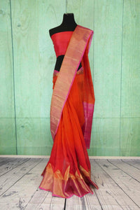 90C182 Traditional red saree with golden border and pink trim. The matka ghicha Banarasi saree online in USA at Pure Elegance is perfect for wedding functions and pujas. This versatile saree is an evergreen one!
