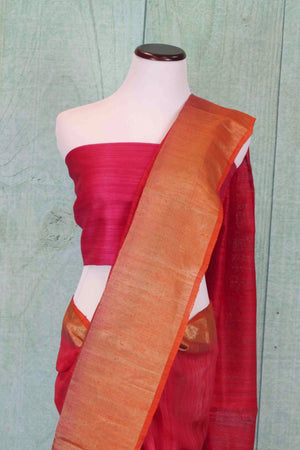 90C182 Traditional red saree with golden border and pink trim. The matka ghicha Banarasi saree online in USA at Pure Elegance is perfect for wedding functions and pujas. This plain saree is a classic hit!