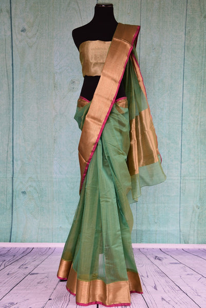 90C191 Ethnic chanderi saree in green with a gold border available online at Pure Elegance.  The lovely, simple sari in USA, is ideal for pujas and festive occasions. The pop of purple along the border gives this saree a nice pop of color.