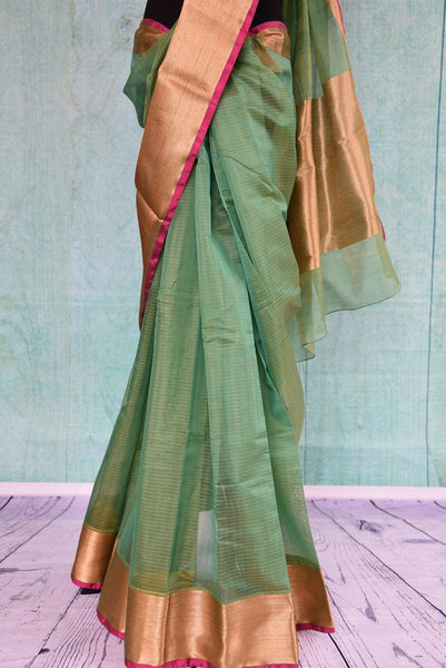 90C191 Ethnic chanderi saree in green with a gold border available online at Pure Elegance.  The lovely, simple sari in USA, is ideal for pujas and festive occasions. This timeless saree can be styled in many ways for very many occasions.