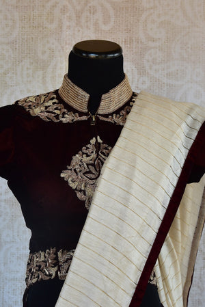 90C218 Off White Matka Silk Saree With A Brown Blouse