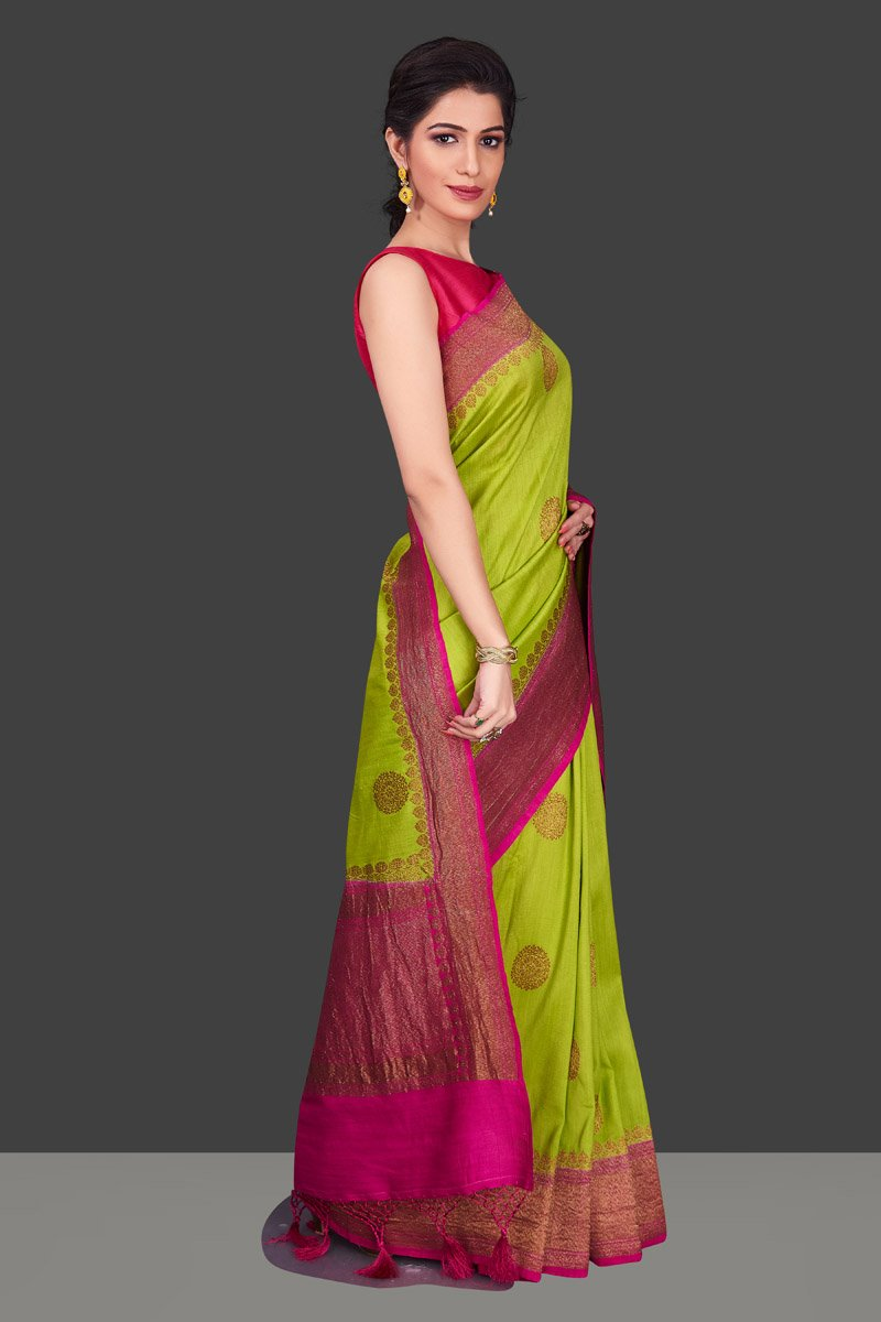 Buy pista green muga Banarasi saree online in USA with pink zari border. Shop beautiful Banarasi sarees, georgette sarees, pure muga silk sarees in USA from Pure Elegance Indian fashion boutique in USA. Get spoiled for choices with a splendid variety of Indian saris to choose from! Shop now.-side