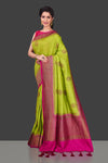 Buy pista green muga Banarasi saree online in USA with pink zari border. Shop beautiful Banarasi sarees, georgette sarees, pure muga silk sarees in USA from Pure Elegance Indian fashion boutique in USA. Get spoiled for choices with a splendid variety of Indian saris to choose from! Shop now.-full view