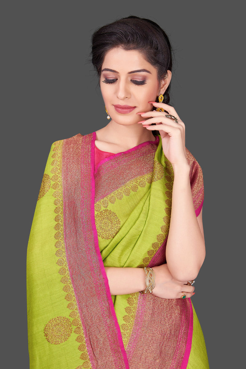 Buy pista green muga Banarasi saree online in USA with pink zari border. Shop beautiful Banarasi sarees, georgette sarees, pure muga silk sarees in USA from Pure Elegance Indian fashion boutique in USA. Get spoiled for choices with a splendid variety of Indian saris to choose from! Shop now.-closeup