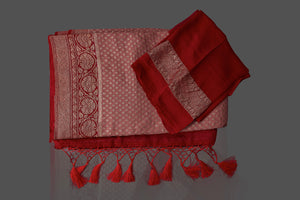 Buy charming dusty pink georgette Banarasi saree online in USA with red zari border. Shop beautiful Banarasi sarees, georgette sarees, pure muga silk sarees in USA from Pure Elegance Indian fashion boutique in USA. Get spoiled for choices with a splendid variety of Indian saris to choose from! Shop now.-details